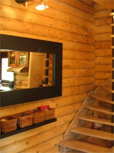 Внутренняя отделка дома из оцилиндрованного бревна